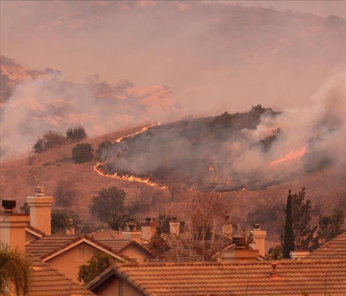 Wild Fire Approaching Roof-Tiled Homes
